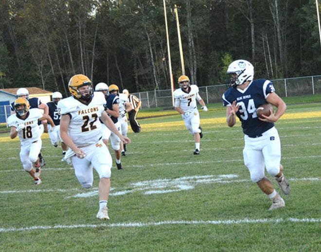 Sault High's Ryan LaPlaunt (34) runs for a first down against Ogemaw Heights. The Blue Devils visit Grayling this Friday night.