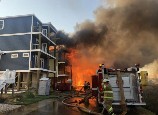 Crews on the scene of a 2019 fire that destroyed multiple homes in Surf City.
