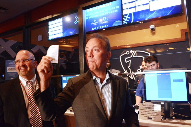 Connecticut Gov. Ned Lamont holds the first sports betting slip next to James Gessner, Mohegan Sun tribal chairman, Thursday during the first day of sports betting at the Mohegan Sun Casino. Foxwoods Resort Casino also started sports betting Thursday. (John Shishmanian/NorwichBulletin.com)