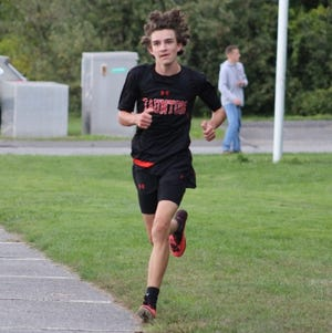 Taunton's Andrew Cali (file photo) finished third against Mansfield and was a key part of the Tigers' undefeated season