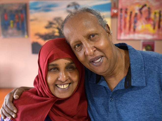Fatima Mohamed and her husband, Omai Issa, at Fatima's Cafe in Worcester.