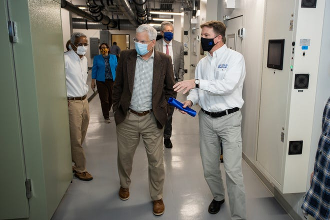 J. Scott Angle, left, tours the UF/IFAS Growth Chamber Facility with Dean Kopsell, right, and other attendees at the facility's ribbon cutting event in January of this year.