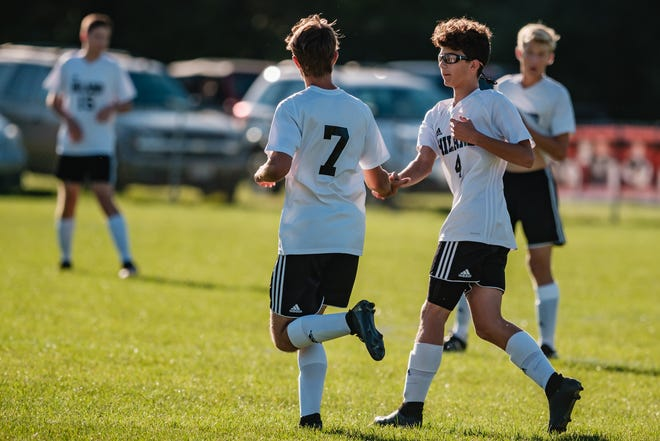 Hiland's Caelan Howell, left, is congratulated by Sam Anderson on Howell's first goal of the game against Tusky Valley Thursday night at Zoarville.