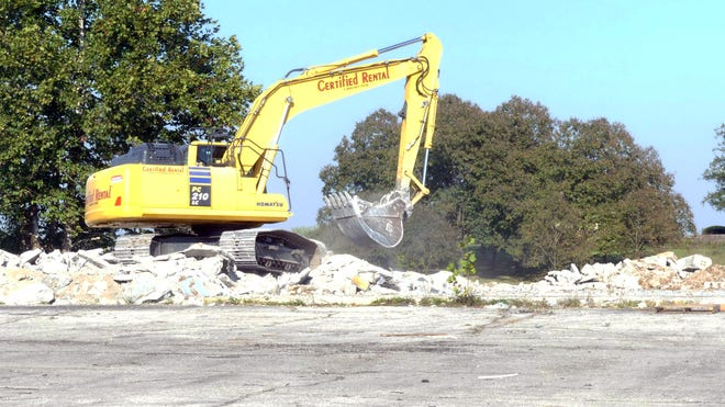 A crane removes ruble from the old Orscheln Farm and Home store so that the site can be cleared for an incoming Dollar General store.