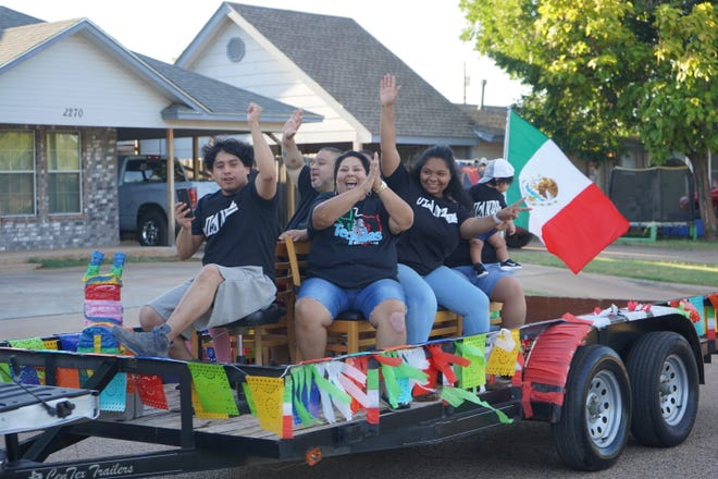 """Revelers take a ride at the """"16 de Septiembre"""" parade which marked the start of Hispanic heritage month."""