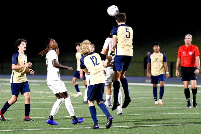Roberson defender Coulson Dunning wins a header during the Rams' 3-1 win over Reynolds on Sept. 29, 2021.