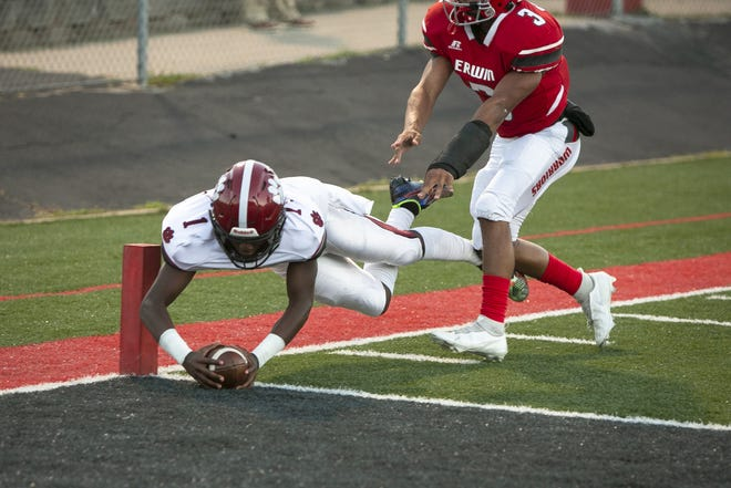 Asheville quarterback Khalil Conley dove in to the endzone for a touchdown on September 24, 2021 as Asheville faced Erwin at Erwin.  Asheville took the win with a final score of 49-14.