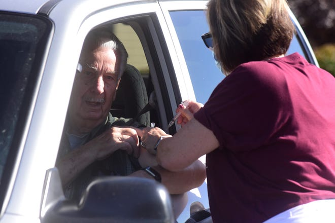 Don Johnson of Bucyrus was one of nearly 100 patients who received a flu shot during a drive-thru clinic Wednesday afternoon at Crawford County Public Health.