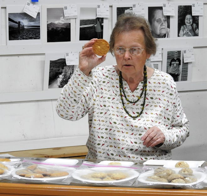 Judge Carol Miller reviews white chocolate macadamia nut cookies made by juniors of the Coshocton County Career Center at the Coshocton County Fair.
