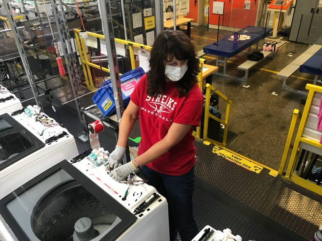 A Whirlpool employee at Clyde's plant works on an electronic console in October 2020. The company is celebrating Manufacturing Day Friday by releasing a video that celebrates its workers and their contributions to the company.
