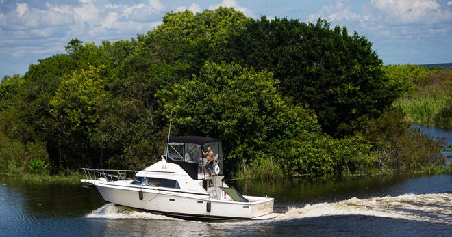 Boaters move through the outer portions of Lake Okeechobee in Clewiston on Thursday, September 30, 2021.