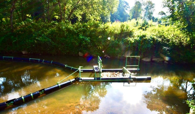 This Bandalong, which traps floating debris in the Reedy River, is part of a pilot project of Renewable Water Resources (ReWa)