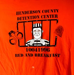 """The front of T-shirts that were given to participants in the """"First Nighter"""" fundraiser at the Henderson County Detention Center Oct. 4, 1996, right before the new $6.2 million jail  began operations. About 100 people attended the event -- but not one stayed overnight -- although about 140 contributed $50 each to the fundraiser, which benefited five local non-profit organizations. (Frank Boyett photo)"""