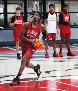U of L's Dre Davis (14) drives to the basket during the first practice of the season at the Kueber Center in Louisville, Ky. on Sep. 30, 2021.