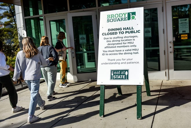 Students walk inside the Brody Square dining hall on Thursday, Sept. 30, 2021, on the MSU campus in East Lansing. The dining hall is closed to the public due to a staffing shortage.