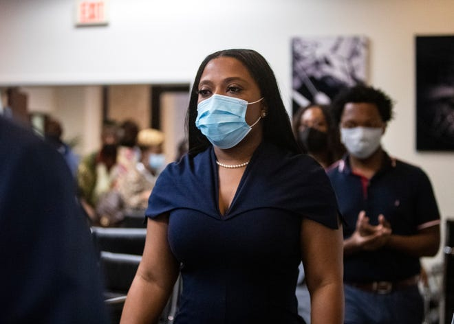 Katrina Robinson walks into a press conference following her conviction on wire fraud charges on Thursday, Sept. 30, 2021, in Memphis, Tenn.