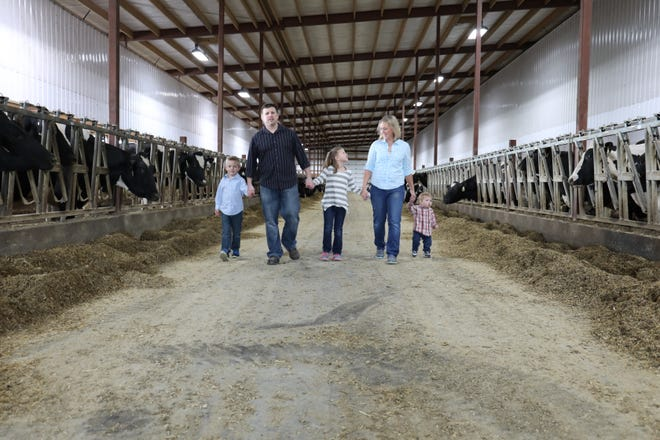 Karen Hughes, herd manager and co-owner of Sunset Farms in Allentown, is shown with family.