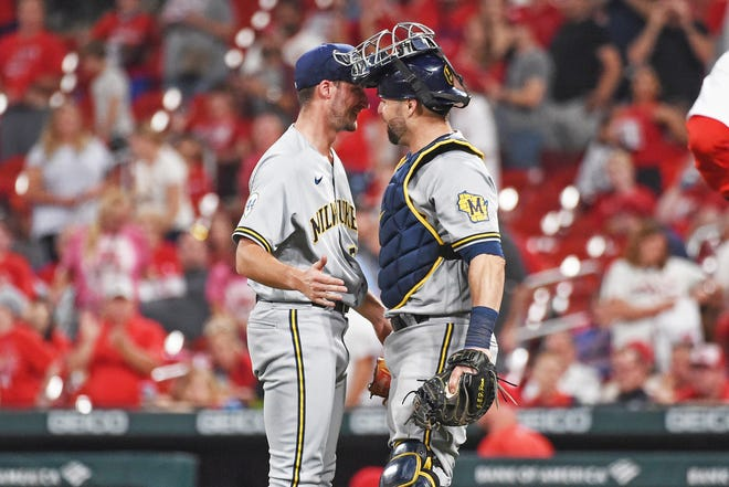 Brewers pitcher Aaron Ashby and catcher Manny Pina celebrate their team's 4-0 victory over the Cardinals on Wednesday night.