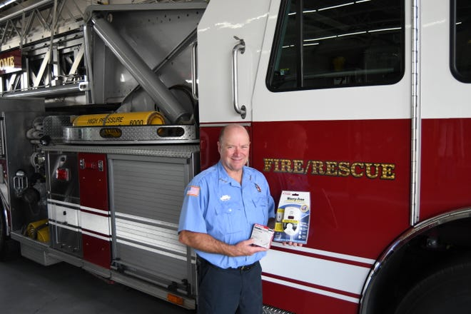 """Mountain Home Fire Inspector Shawn Lofton holds a smoke detector and carbon monoxide monitor. National Fire Safety Week is Oct. 3-9, and the national theme for this year is """"Learn the Sounds of Fire Safety."""""""