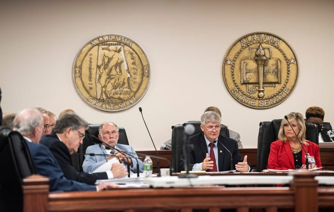 Committee Chair Sen. Greg Albritton, middle, speaks during a Finance and Taxation General Fund Committee hearing at the Alabama State House in Montgomery, Ala., on Thursday, Sept. 30, 2021.