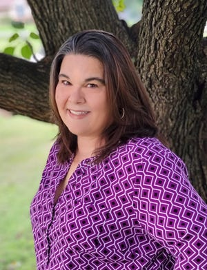 Gina Iser works as a court advocate for victims of domestic violence in Williamson County.
