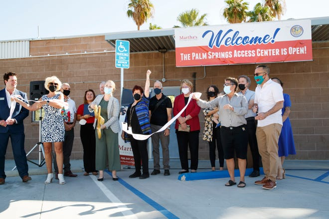 Linda Barrack, CEO of Martha's Village and Kitchen, center, celebrates by raising her arm after the ribbon cutting ceremony for the Palm Springs Access Center in Palm Springs, Calif., on September 30, 2021. Palm Springs Access Center is a daytime drop-in facility offering wraparound services for individuals experiencing homelessness.