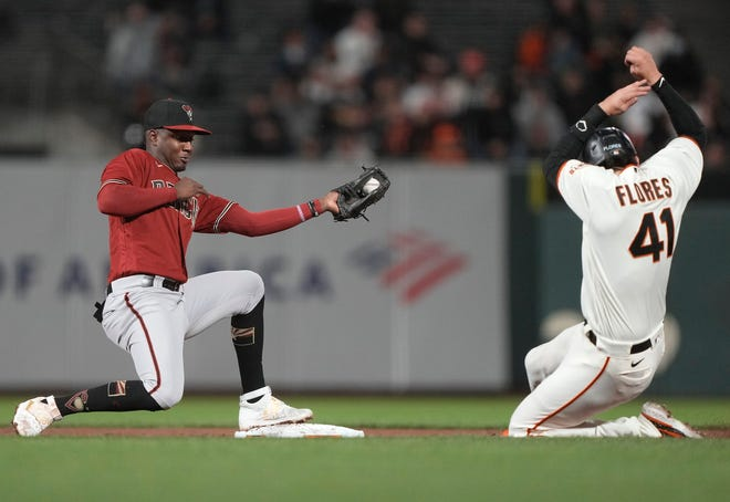 SAN FRANCISCO, CALIFORNIA - SEPTEMBER 29: Geraldo Perdomo #2 of the Arizona Diamondbacks gets the putout at second base on Wilmer Flores #41 of the San Francisco Giants in the bottom of the second inning at Oracle Park on September 29, 2021 in San Francisco, California. (Photo by Thearon W. Henderson/Getty Images)