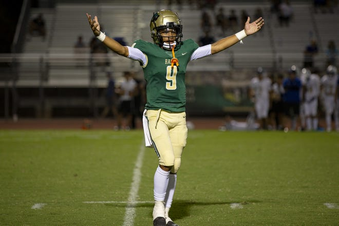Basha High School quarterback Demond Williams (9) celebrates points gained during a game against Sandra Day O'Connor High School on Sept. 3, 2021 at Basha High School in Chandler. Monica D. Spencer/The Republic 5674119001