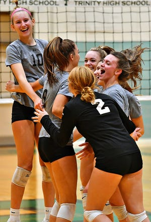 York Suburban celebrates a 3-2 win over Trinity during girls' volleyball action at Trinity High School in Lower Allen Township, Wednesday, Sept. 29, 2021. Dawn J. Sagert photo