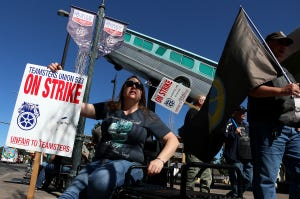 RTC bus driver Lisa Hickman, left, and other members of Teamsters Union 533 are seen while on strike at the 4th Street Bus Station in Reno on Sept. 30, 2021.