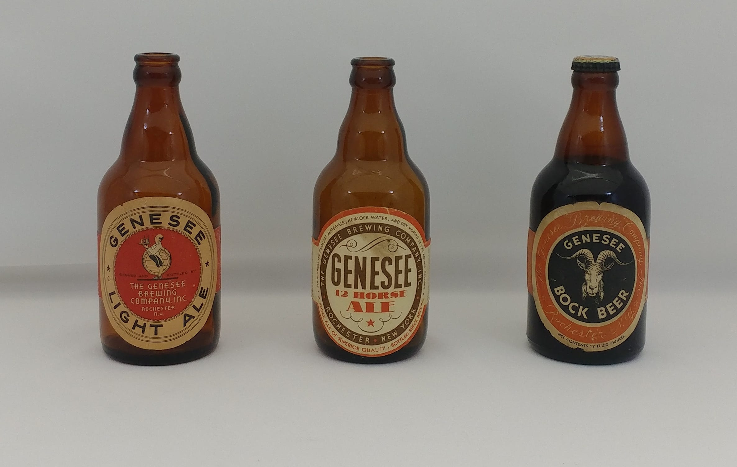 Three Genesee steinie (or stubby) bottles: Genesee Light Ale (1938 to 1941), 12 Horse Ale (1933 to 1936), and Bock (1933 to 1936).