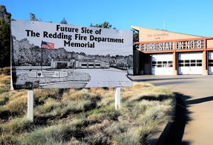 A sign outside Fire Station No. 8 on Churn Creek Road says it's the future site of a Redding Fire Department memorial that will honor firefighters who have both died on active duty and others who have passed away. Jeremy Stoke was a Redding fire engineer who died July 26, 2018, in the Carr Fire, and was assigned to Station 8.