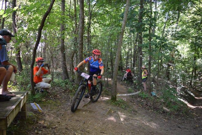Jane Murr takes a corner along a mountain bike path.