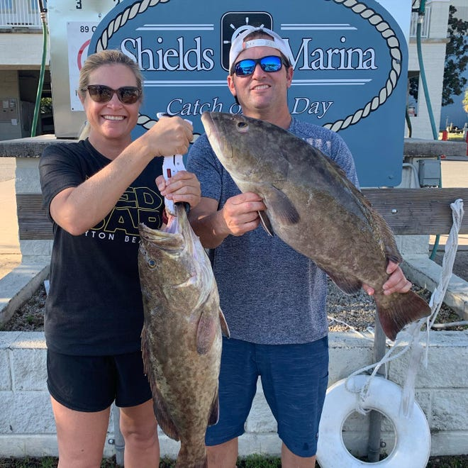 Justin and Leslie Evans hold up a couple of fall gag's caught last weekend in what many consider shallow water.