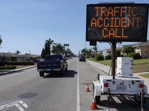 A mobile sign near the scene of a hit-and-run crash that killed a teenage bicyclist on Hemlock Street in Oxnard Wednesday night asks witnesses to call police.