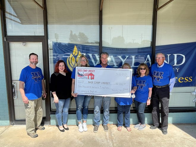 Members of the Wayland Baptist University faculty and staff in Wichita Falls made a $1,000 donation to Base Camp Lindsey to help the organization in its mission to assist homeless veterans. Pictured with Tara Bryant of Base Camp Lindsey (second from left) are Wayland faculty and staff members Dr. Jeff Tillman (from left), Wendi Dunlap, Dr. Jerry Faught, Pam Landis, Joy Crowley and Dr. Lloyd Cannedy.