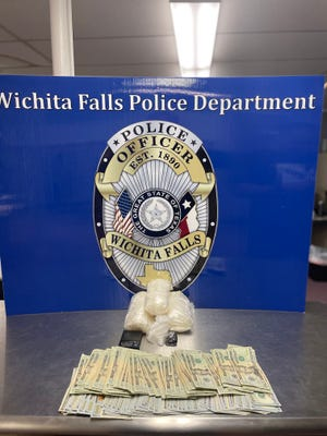 Police display drugs and money taken in a bust at a WIchita Falls motel Thursday.
