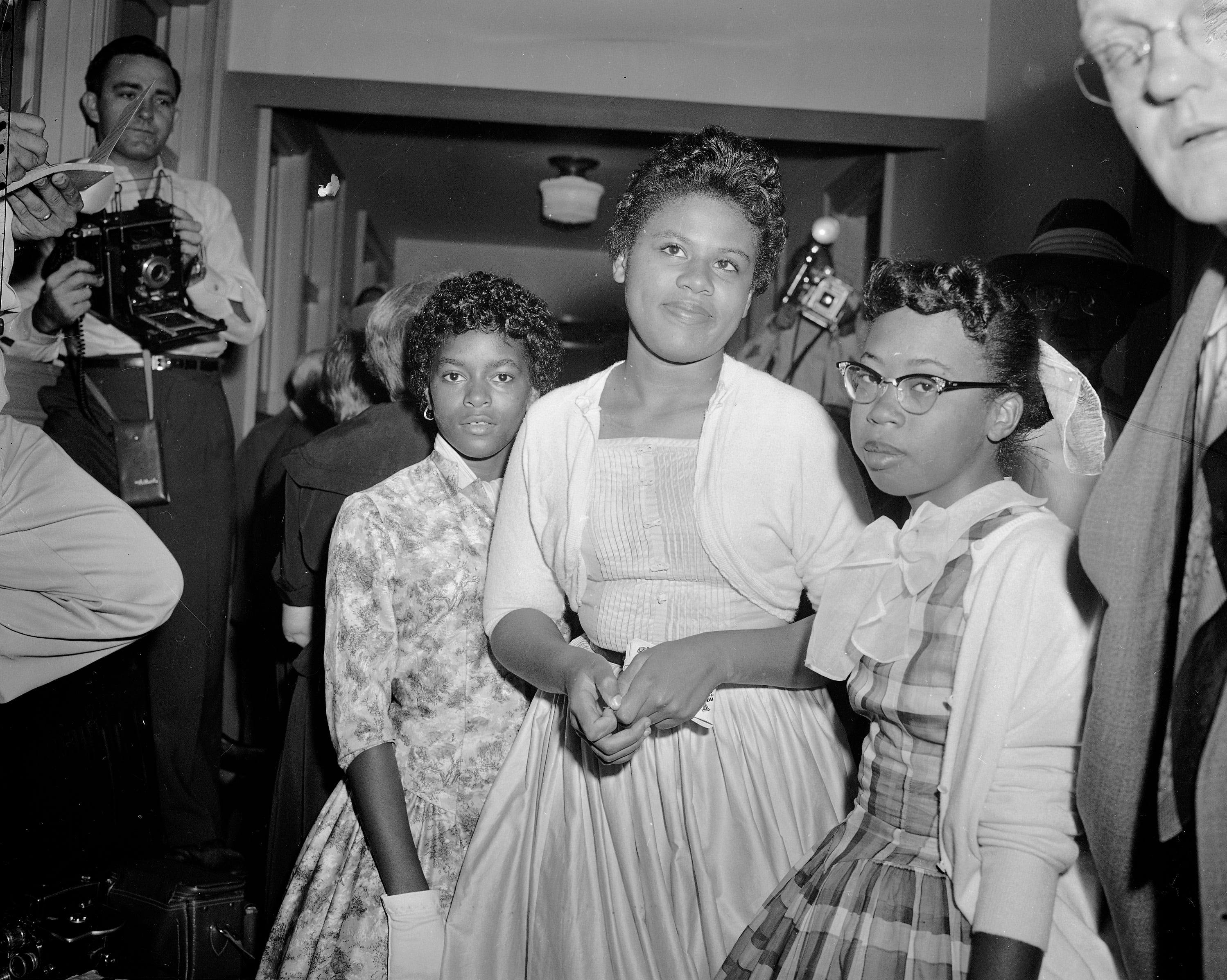 From left, Dorothy Frazier, 13, Minnie Brown, 15, and Thelma Mothershed, 16, wait in a corridor of the U.S. Courthouse at Little Rock, Arkansas, where they were called to testify at a hearing on the integration problems at Central High School, Sept. 7, 1957.  Thelma and Minnie were two of the students who were turned away by the National Guard as they attempted to enter the building on the first day of school.