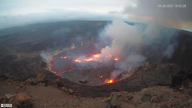 This webcam image, provided by the U.S. Geological Survey, shows the scene of an eruption that began in the Halemaumau Hole on the summit of Kilauea Volcano in Hawaii, Wednesday, September 29, 2021.
