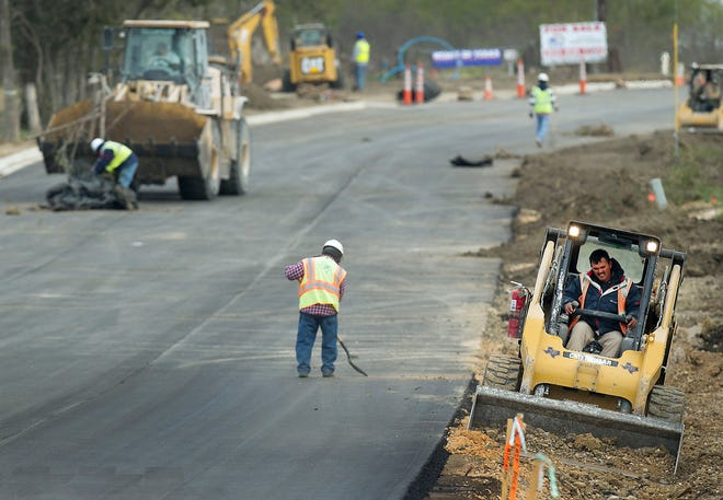 Road crews are shown working on a Travis County road project in 2012. Proposition 2 would provide another financing tool for counties to pay for road projects and other infrastructure.