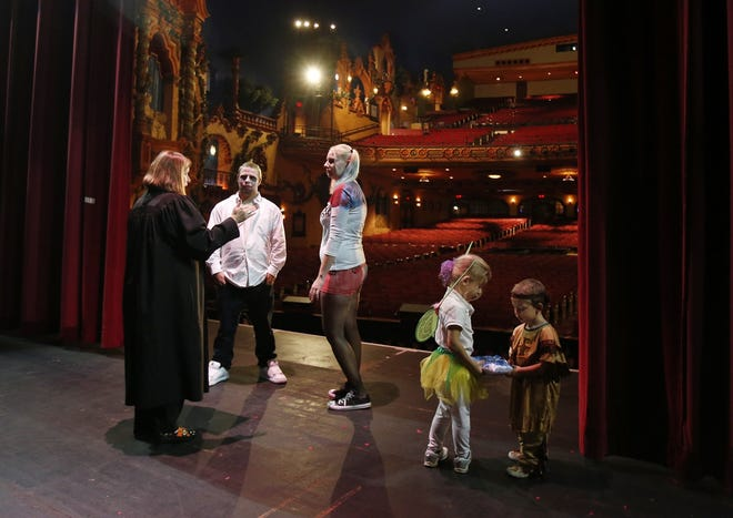 Akron Municipal Court Judge Katarina Cook presides at a Halloween day wedding ceremony at the Akron Civic Theatre in 2016.