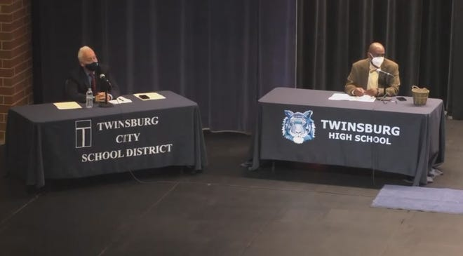 The Twinsburg Board of Education voted 3-2 to approve a contract with a Columbus marketing firm. Those voting for included board members Rob Felber, left, and Mark Curtis.