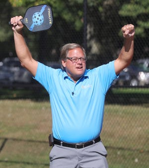 Tallmadge Mayor David Kline reacts after scoring a point on Stow Mayor John Pribonic during a Move With the Mayor pickleball game Friday at Lions Park in Tallmadge.