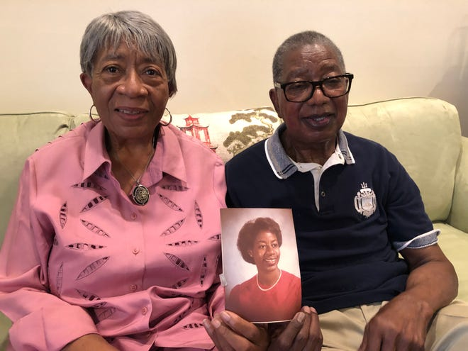 Retired U.S. Navy Capt. J.C. Williams and his wife, Eleather, of Martinez, hold an undated school photo of their daughter Angela, who in September was named the new president and chief executive officer of United Way Worldwide.