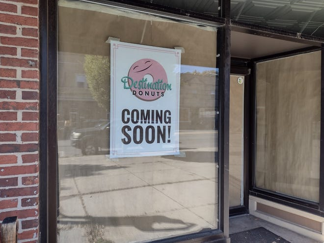 A sign announcing that Destination Donuts is coming to Clintonville in the fall.