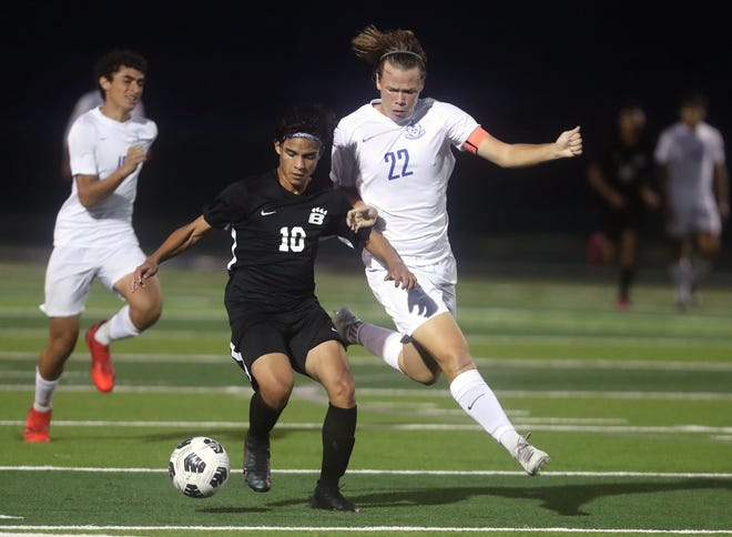 Senior midfielder Lucas Baker (22) and Davidson are enjoying a turnaround season under first-year coach Pat Billman. Coming off a 5-9-2 finish last fall, the Wildcats were 6-1-5 entering an OCC-Central matchup against Olentangy Liberty on Oct. 5.