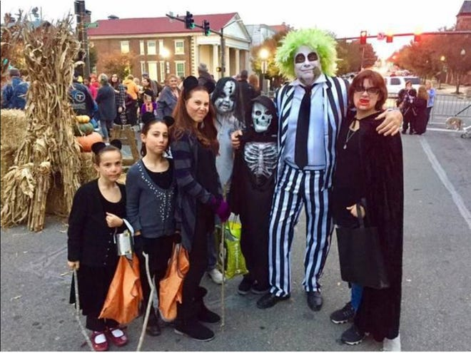 A few spooky kids pose with Beetlejuice (Dr. Terry Hendrickson) during Columbia's annual Haunting in the District in 2018.