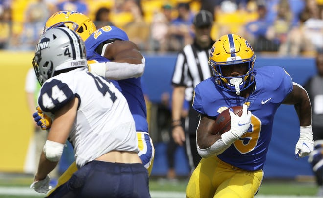 Sep 25, 2021; Pittsburgh, Pennsylvania, USA;  Pittsburgh Panthers running back Rodney Hammnd Jr. (9) rushes the ball against the New Hampshire Wildcats during the third quarter at Heinz Field. Pittsburgh won 77-7. Mandatory Credit: Charles LeClaire-USA TODAY Sports