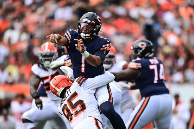 Chicago Bears quarterback Justin Fields (1) is hit by Cleveland Browns defensive tackle Myles Garrett (95) after a pass during the second half of a game Sunday, Sept. 26, in Cleveland.