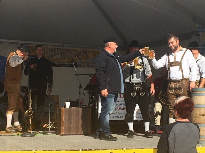 Oktoberfest officially started Friday morning with the tapping of the keg at Hays Municipal Park.